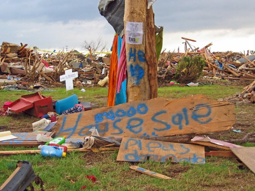Home owners left signs, materials, cars, and flags such as these tohelp to cope with the disaster.