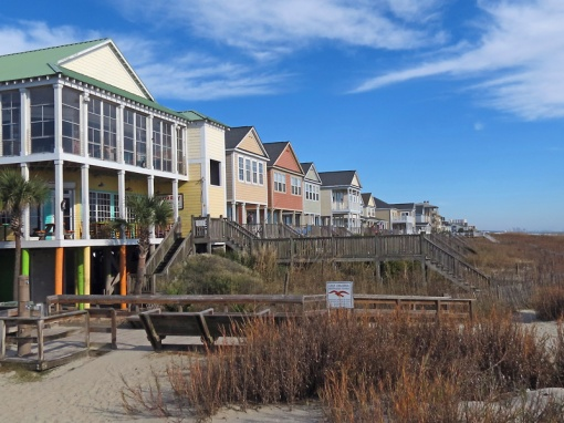 This view shows housing on the beach north of a fishing pier around Surfside Drive
