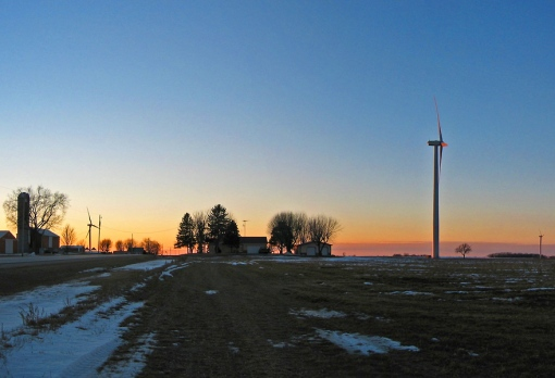 The Wind Farm turns and produces electrical energy for homes as the sun sets in Brownsville, Wisconsin