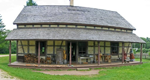 The 180's farm house shows the back porch activities of chopping wood, churning butter, pressing, ice box, washing, sorting, and baking.