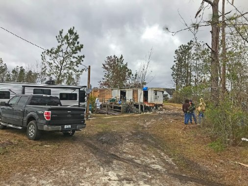 New trailer with damaged home trailer